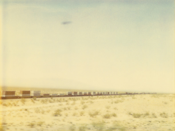 Train Crosses Plain